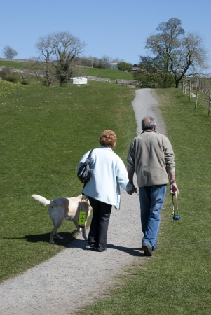 Elderly couple walking on path in Grassington, Yorkshire Dales  photo