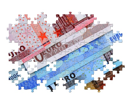 partially: Partially completed jigsaw puzzle of Euro banknotes