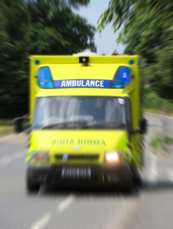 Ambulance in road with zoom effect focusing on sign  Imagens