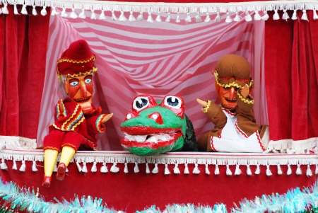 Closeup of Punch and Judy show with crocodile