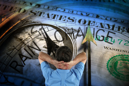 barometer: Closeup of American dollar overlaid with barometer face watched by man  Stock Photo