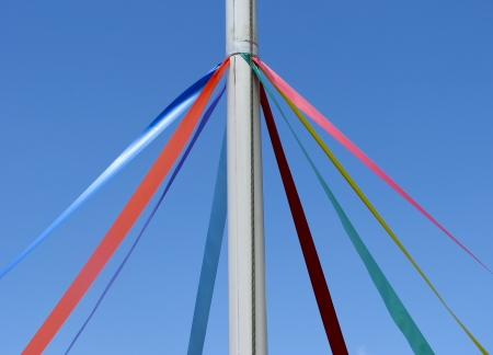 maypole: Telephoto view of Maypole mast and ribbons Stock Photo
