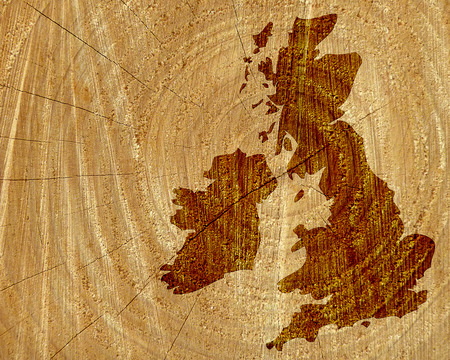 ireland map: Sawn tree trunk overlaid with outline map of UK and Ireland