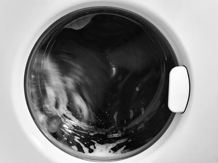 Closeup of modern washing machine in action photo