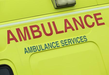 Closeup of sign on NHS ambulance vehicle