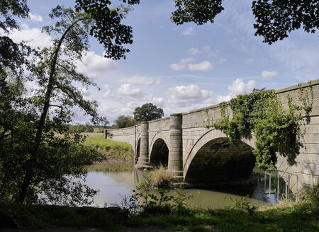 north yorkshire: View of road bridge which crosses the River Derwent near Howsham Mill, North Yorkshire.