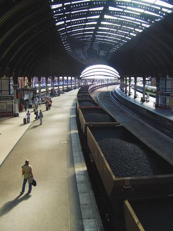 Coal train passes through railway station