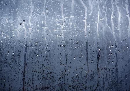 Rain water and condensation clings to window Foto de archivo