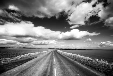 high contrast: High contrast view of countryside road with dramatic sky Stock Photo