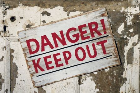 keep out: Closeup of weathered Danger Keep Out sign Stock Photo