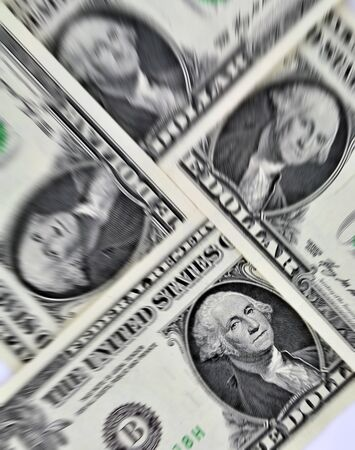 capitalism: Closeup of four us dollar bills with added zoom effect Stock Photo