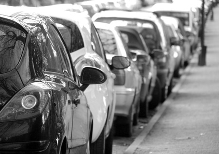 crowded space: Black and white photograph of cars parked in city centre Stock Photo