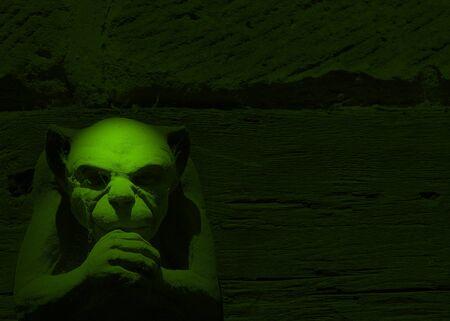 gargoyle: Spotlight effect on gargoyle figure toned green