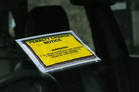 Closeup of a UK parking ticket penalty charge notice