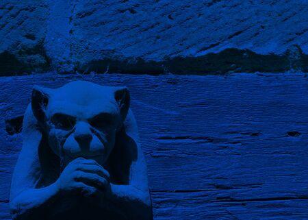 gargoyle: Leghting effect on gargoyle figure toned blue