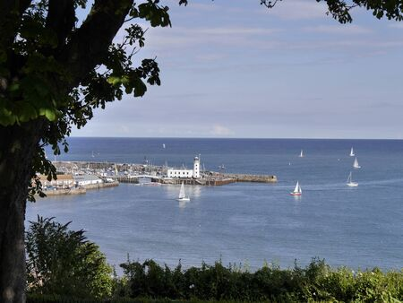 north yorkshire: SCARBOROUGH, North Yorkshire, UK: Circa August 2014 - Yachts sail outside of Scarborough harbour.