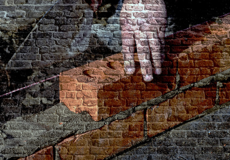hand trowel: Image of old brick wall overlaid with bricklayer image