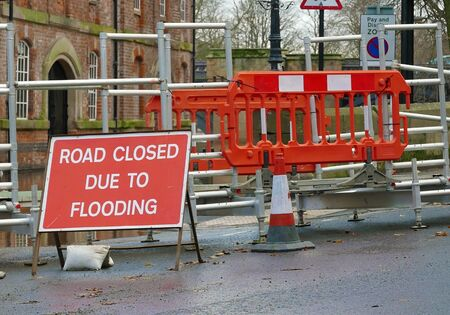 YORK, NORTH YORKSHIRE, UK - Circa December 2015: Road close sign in front of pedestrian walkway crossing flooded water.