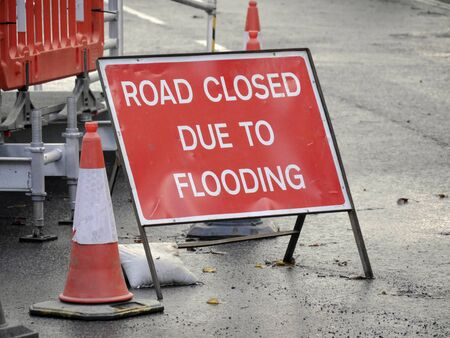 Closeup of Road Closed sign after flooding in city street. Stock Photo