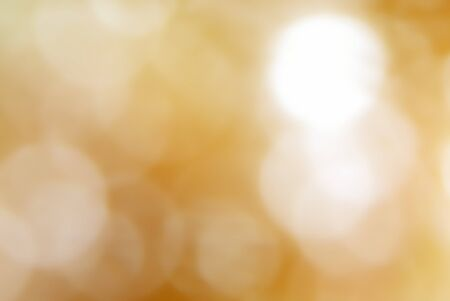 light brown: Bokeh light spots on brown blurred background