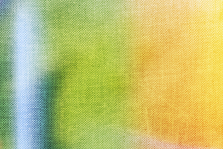 canvas texture: Yellow, green and blue colours applied to canvas texture