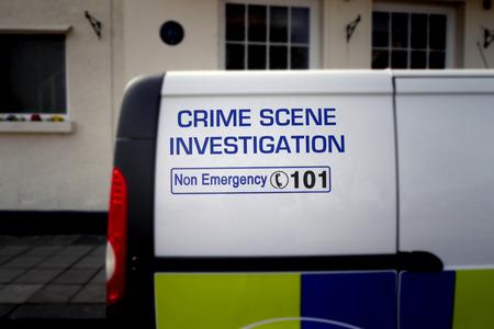crime scene investigation: Telephoto view of Crime Scene Investigation sign on side of police van. Stock Photo