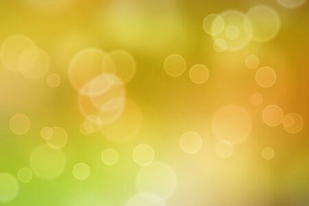 textured effect: Bokeh light circles applied to yellow blurred background