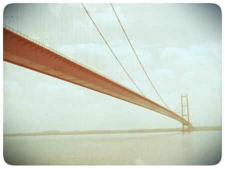 suspension bridge: Faded old film effect applied to image suspension bridge over the River Humber