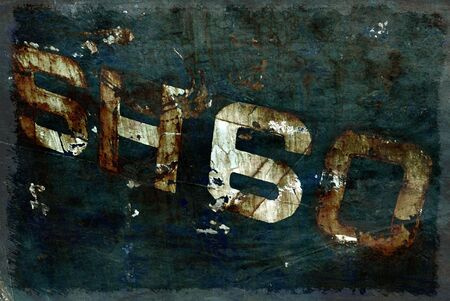 moody: Dark moody grunge effect applied to numbers on letters on rusty boat