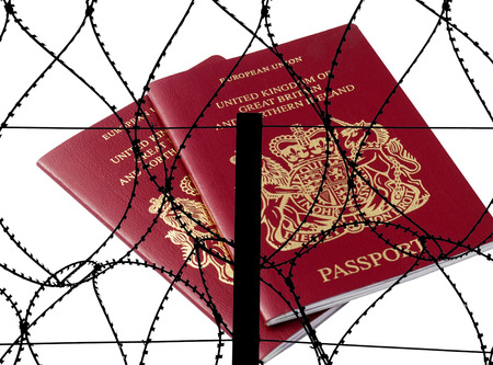 restrictions: Two british passports overlaid with silhouette barbed wire