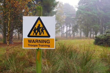 troop: Troop warning sign in wooded training area Stock Photo