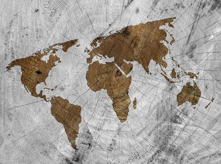 sawn: Outline map of world on sawn tree stump.