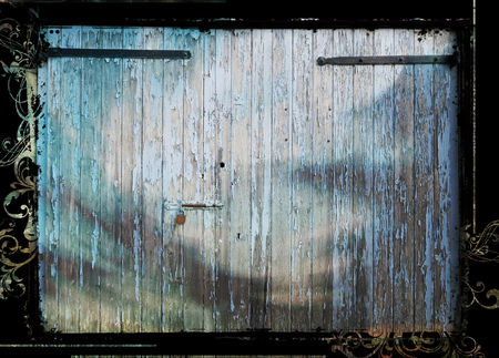 flaky: Old flaky doors with lighting effects and grunge edges.