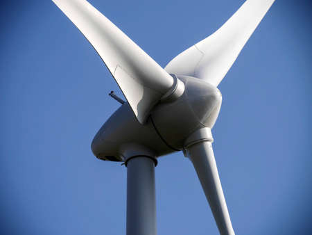 blades: Closeup image of wind generator propeller with vignette edges.