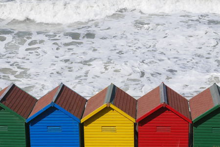 whitby: Row of colorful beach huts at Whitby, North Yorkshire, UK.