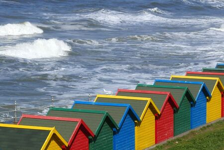 beach huts: Row of colorful beach huts at Whitby, North Yorkshire, UK.