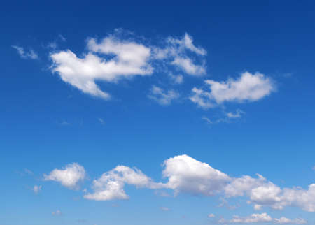 wispy: Wispy white clouds float through blue summer sky
