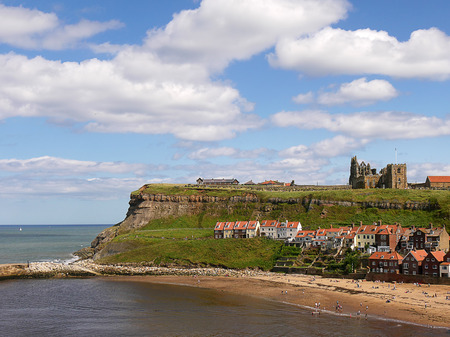 Wide angle view of the coastal town of Whitby, North Yorkshire, UK. Whitby is one on Yorkshires most popular seaside resorts which attracts holiday makers and day-trippers throughout the year. Bram Stoker is said to have featured this Whitby coastline in
