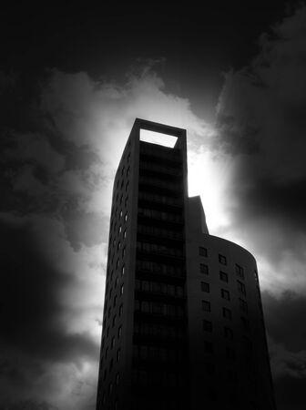 Darkly lit city tower block with added dark edges for effect.