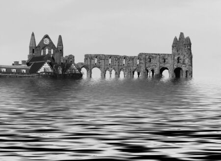 Black and white ruins of Whitby Abbey with simulated flood water effect.
