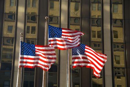 3 american flags against building Banco de Imagens