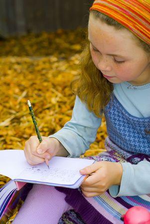 girl writing in diary
