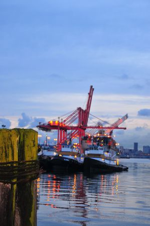 Tug Boats and container harbor Stock Photo