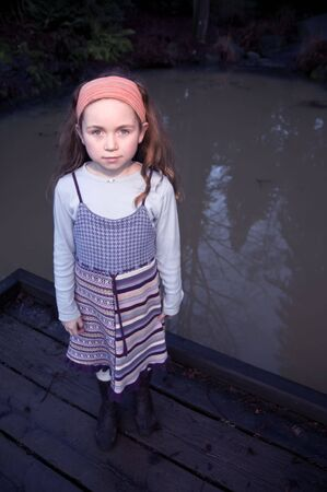inocent: girl standing by pond