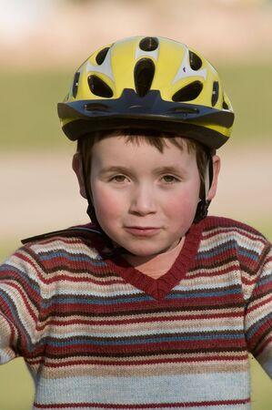 lucas: boy on bike, girl running beside him Stock Photo