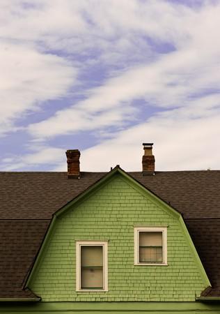 dakvenster van Nederlandse conlonial huis Stockfoto