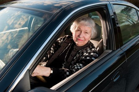 86 year old woman driving her car photo