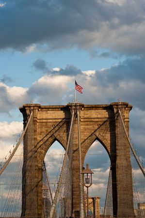 detail of western bridge standard with american flag on top.  new york city