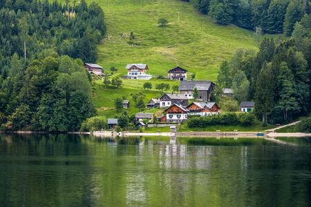 village on a hill near the lake, alps mountains, Austria