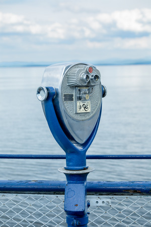 Binoculars operated by coins near the sea
